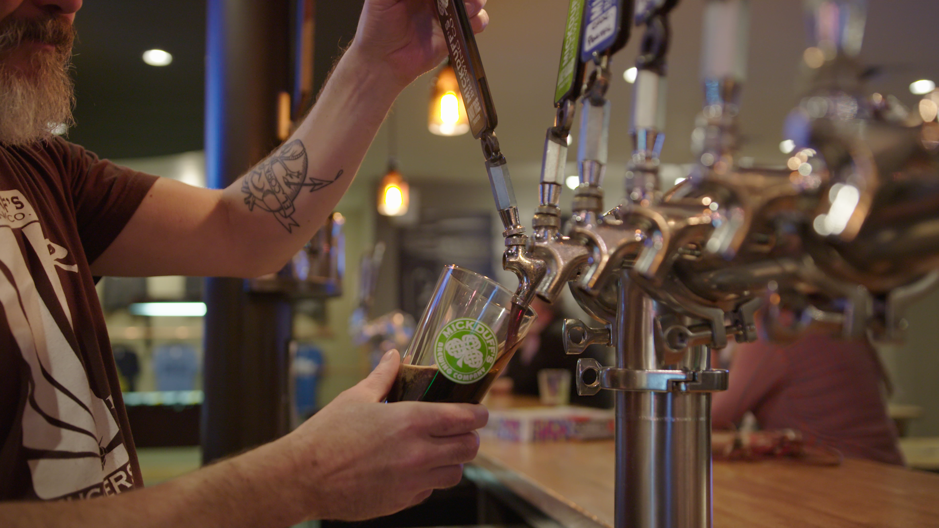 A man pours a beer from the tap at the bar in Idaho
